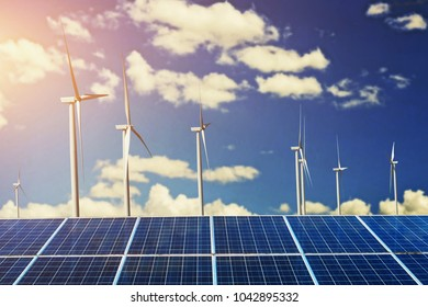 solar panels with windmill and sunshine blue sky background. concept cleans energy in nature