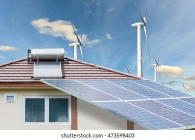 Solar panels,wind turbines on blue sky background,natural Energy