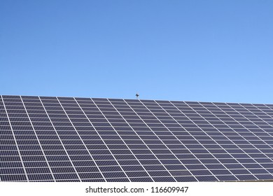 Solar photovoltaic cells on the background of blue sky