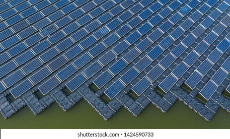 Solar photovoltaic panel in aerial view, Row polycrystalline silicon solar cells or photovoltaic in solar power plant floating on water in lake, Alternative Ecosystem and healthy environment concepts.