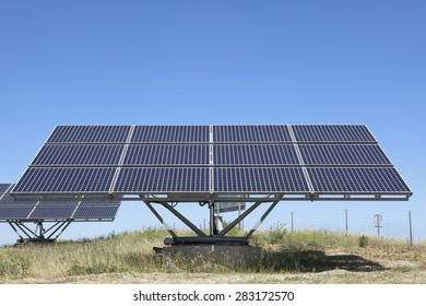 Solar photovoltaic panels field for renewable energy production with blue sky, Spain