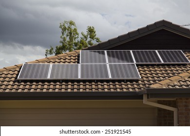 Solar photovoltaic panels installed on tiled roof