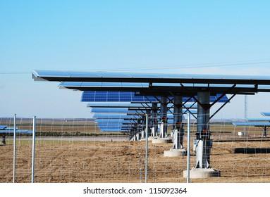Solar photovoltaic panels on clear blue sky.