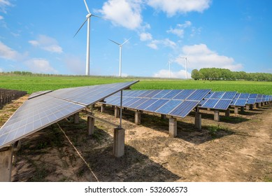 solar photovoltaics panel and wind turbines generating electricity