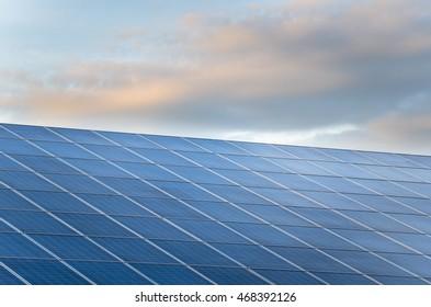 Solar Plant at Sunset. Renewable Energy.