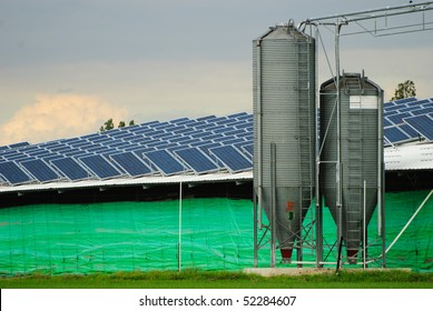 Solar power collectors installation on a farm building