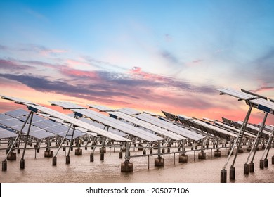solar power farm in  sunset , develops coastal tidal flats and green energy
