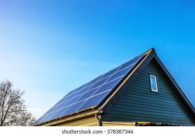 Solar power generation technology on house roof, alternative energy and environment protection ecology.