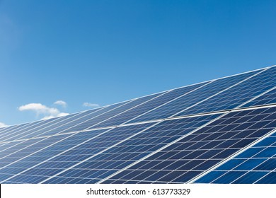 solar power panels against a blue sky,  clean energy background