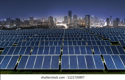 Solar power panels with city lights