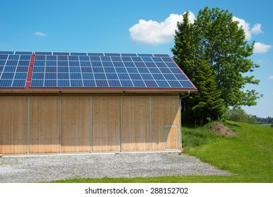 solar power panels on roof of new barn in summertime