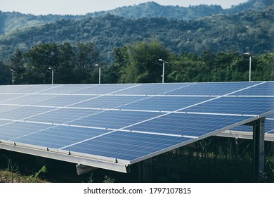 Solar power panels station with outdoor landscape background. Environment electricity renewable sun energy. Photovoltaic eco-green technology research saving. Business battery cell array clean system.