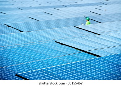 At  solar power plant. Engineer  manager order the worker have to do report  about solar energy from the station everyday. Sunlight is importance for green industry to  generate electricity or heat.
