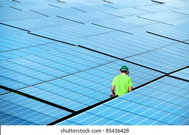 At  solar power plant. Engineer  manager order the worker have to do report  about solar energy from the station everyday. Sunlight is importance for green industry to produce clean energy.