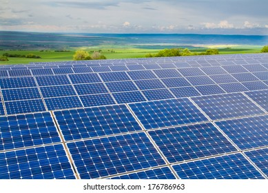 Solar power plant on the background of green fields