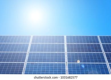 Solar power plant panels, alternative energy background with sun and blue sky