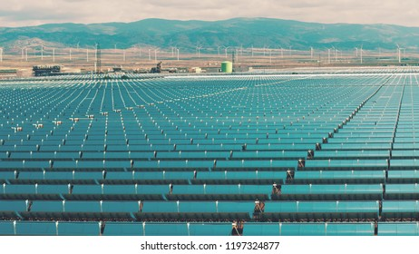 Solar power plant and wind farm in Spain, aerial view. Clean energy production