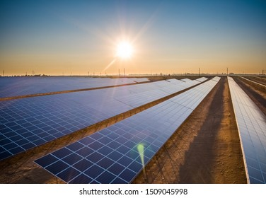 Solar Power Station - Aerial View: Long Rows of Solar Panels at Sunset