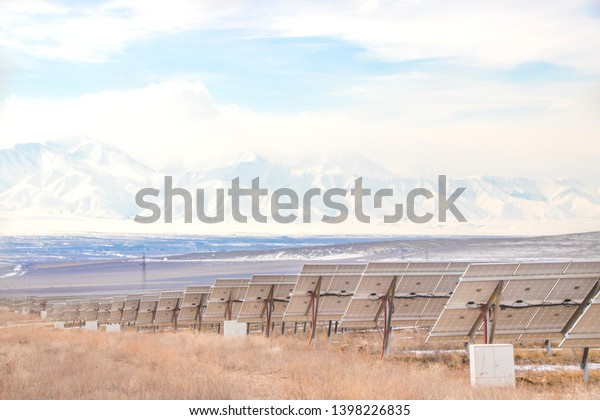 Solar Power Station with mountains. Solar Energy in Kazakhstan