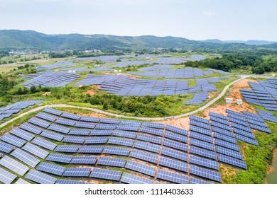 solar power station on hillside, aerial view of renewable energy