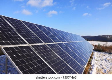 Solar Power Station in the snowy winter Nature