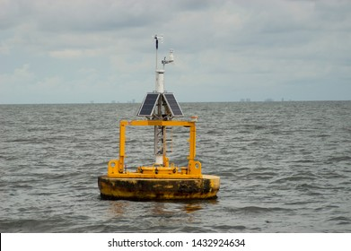 Solar powered buoy in the Gulf of Mexico off the coastline of Orange Beach, Alabama during the summertime measuring oceanographic parameters such as humidity, wind direction and velocity.