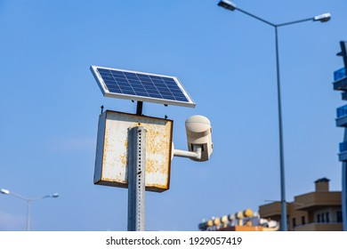 Solar powered camera monitoring system. Smart city part of video surveillance on the urban streets