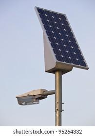 solar powered lamp post under blue sky