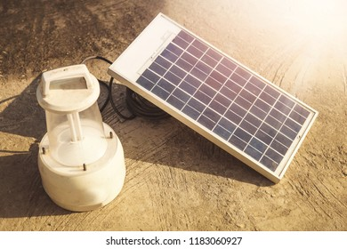 Solar powered lanterns being charged outdoors in India