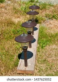 Solar powered walkway lights in a yard