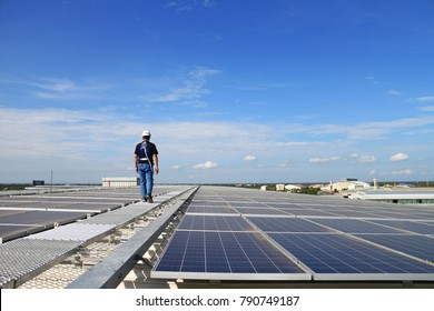 Solar PV Rooftop with Technician Walking