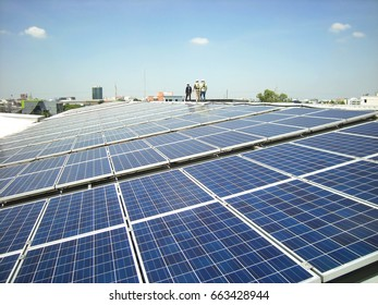 Solar PV Rooftop with Workers Walking