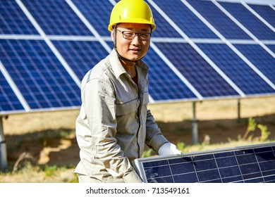Solar PV workers are carrying PV panels