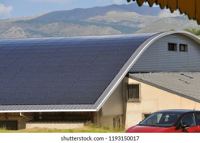 solar roof of a large curved surface on a municipal building of a small village in the Pyrenees