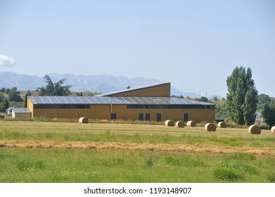 solar roof of a large surface on a farm building of a small village in the Pyrenees