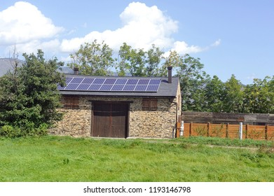 solar roof on a very small barn in a village in the Pyrenees