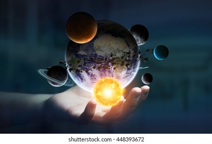 Solar system flying over businesswoman hand on dark office background 'elements of this image furnished by NASA' '3D rendering'