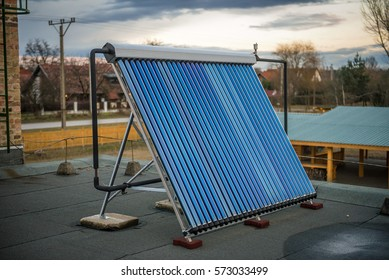 Solar water heater panel installed on a rooftop of a house