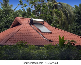 Solar water heater sits on the roof of a home in the Maldive islands