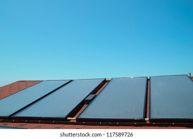 Solar water heating panels on the red roof. Gelio system