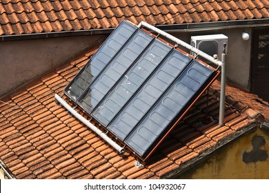 Solar water heating system on the tile roof