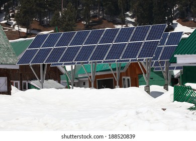 Solarcells generating electricity on a winter with snow mountain