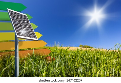 A solar-panel on a green cornfield. EU energy save concept for Energy efficiency Class definition.