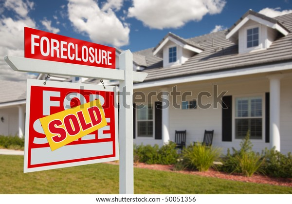 Sold Foreclosure Home For Sale Real Estate Sign in Front of New House - Left Facing.
