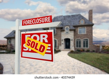 Sold Foreclosure Home For Sale Sign and House with Dramatic Sky Background.