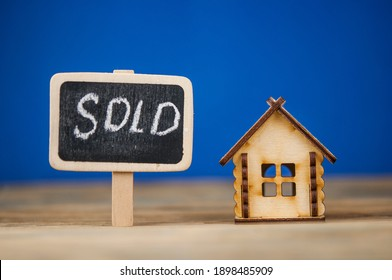 sold house written on wooden boards. Real Estate Concept