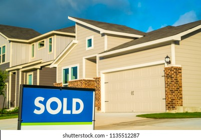Sold. Real estate housing market. Homes and houses for sale in Austin , Texas , USA as the housing market grows worries of a bubble pop is coming. Bright sunshine glow of morning hours on facade