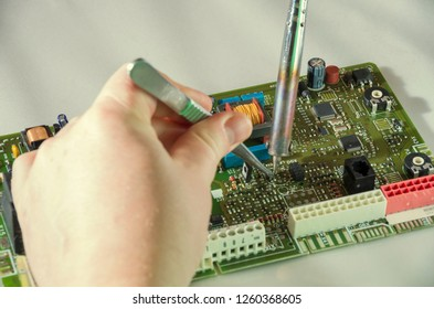 Soldering courses. microelectronics engineering and technology concept. technician or student repairing electronic component.
