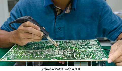 Soldering electronic parts on board and repair power supply.
