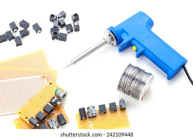 Soldering Gun Shape Placed on a white background isolated with electronic devices and consumer electronics such as audio jack and power jack female put together .